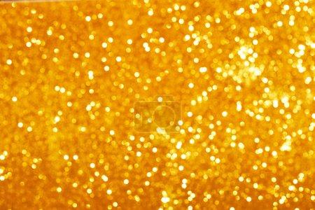 Golden glitter bokeh background.