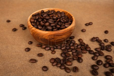 wooden bowl with coffee beans