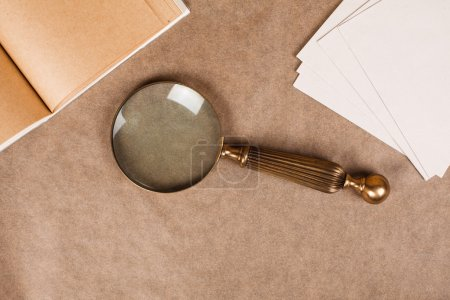 vintage magnifier on paper