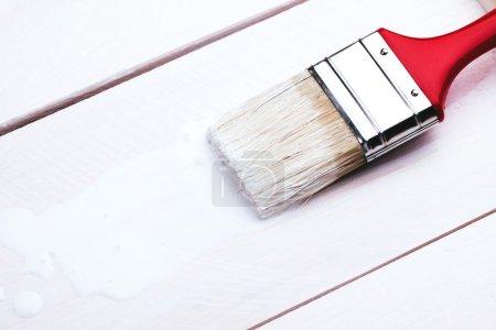 Photo for Varnishing and painting a wooden shelf using paintbrush - Royalty Free Image