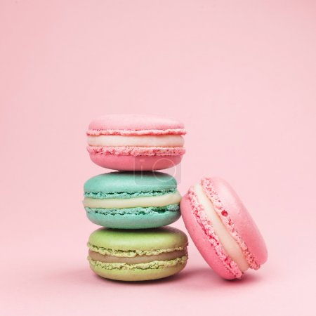 Photo for Sweet and colourful french macaroons on retro-vintage background - Royalty Free Image