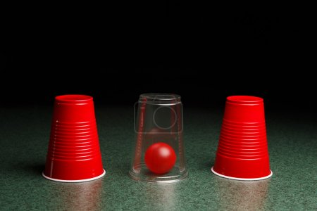 Red Ball Hidden Under Clear Cup