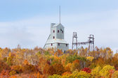 Old Mine Shaft House in Fall Foliage