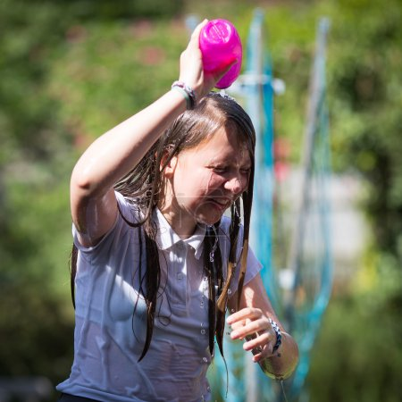 Teenage Girl Cools Down By Throwing Water Over Her Head