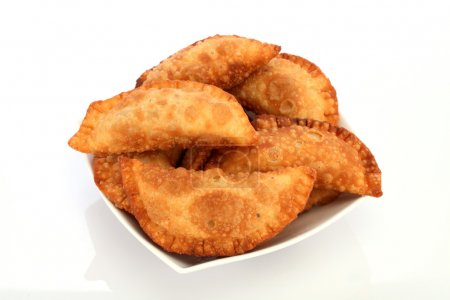 indian snacks in a white bowl