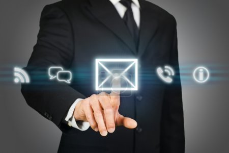 Businessman clicking on email icon