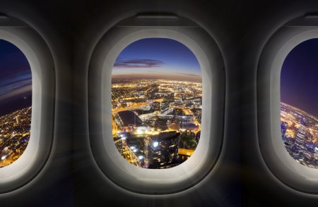 City at night through airplane window