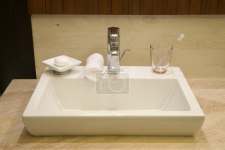 Photo for Basin in a luxury hotel bathroom with amenities - Royalty Free Image