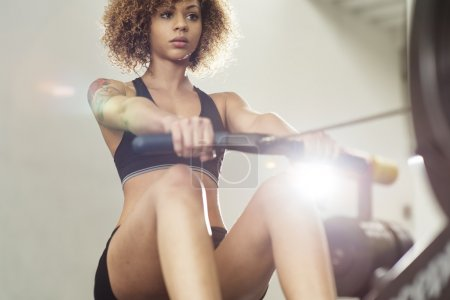 Girl working out on rowing machine