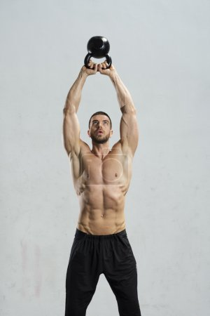 Photo for Young man working out at the gym - Royalty Free Image