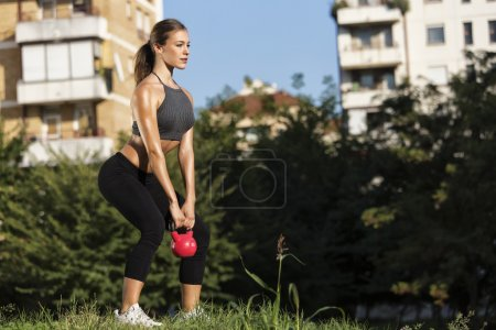 Girl working out with kettlebell
