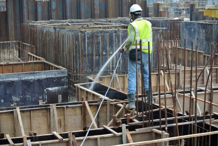 Construction workers spraying the anti termite chemical treatment