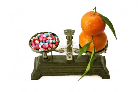 medicament and tangerines on the scales