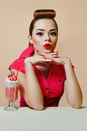 Girl in retro style pin-up style, in a bright dres...