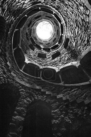 The Initiation well of Quinta da Regaleira in Sintra, Portugal in black and white , downside view