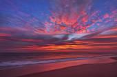 Beautiful cloudscape over the sea, sunrise shot, long exposure.