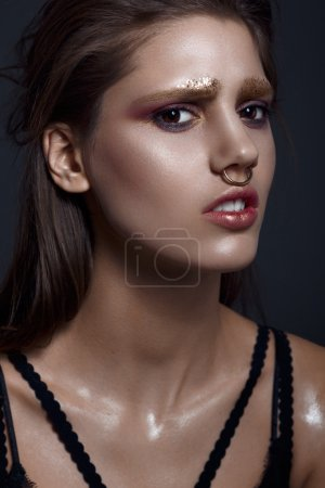 Photo for Fashion beauty portrait of brunette emotional woman with golden ring nose - Royalty Free Image