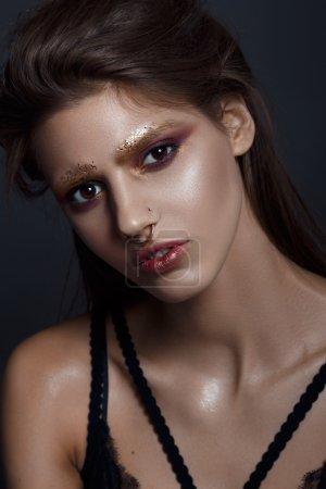Fashion beauty portrait of brunette emotional woman with golden