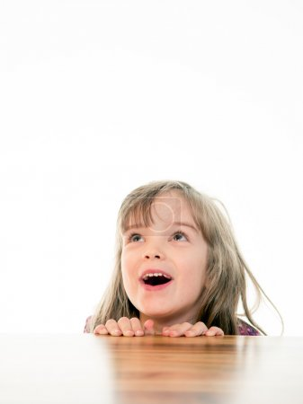 Child looking up with open mouth
