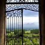 Wrought iron gate facing countryside near Borderau...