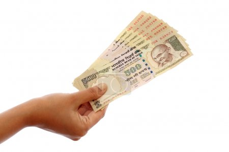 Hand holding Indian five hundred rupee notes