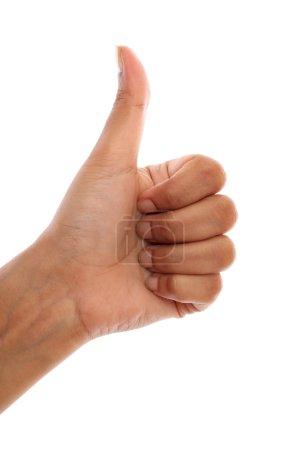 Human hand making thumbs up gesture