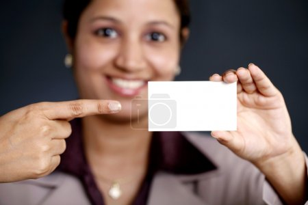 Photo for Closeup of happy business woman showing blank business card - Royalty Free Image