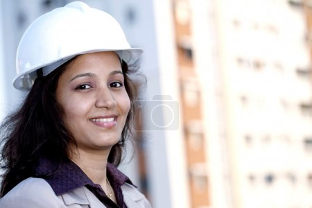Photo for Portrait of smiling young female architect at work place - Royalty Free Image