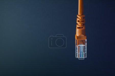 Photo pour Connexion LAN connecteur en plastique orange isolé sur fond noir - image libre de droit