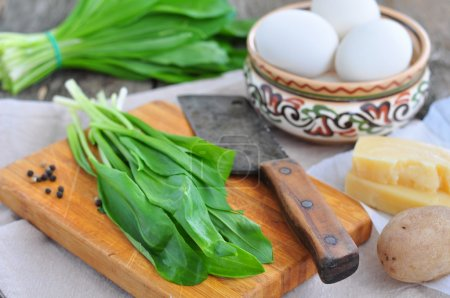 Photo for Green chopped eggs salad with potato, ramson and parmesan cheese - Royalty Free Image