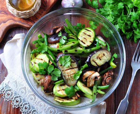 Photo for Grilled vegetables - zucchini, eggplant, green beans, onion, mushrooms, garlic and coriander, olive oil, wine vinegar and light soy sauce. Healthy foods. - Royalty Free Image