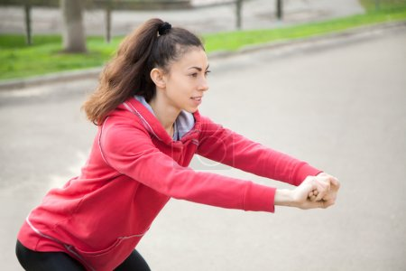 Jogger doing side lunges before running practice