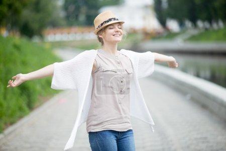 Happy beautiful caucasian woman in summer feeling joyful outdoor