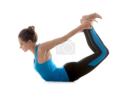 Photo for Sporty yoga girl on white background in Upward Wheel Pose - Royalty Free Image