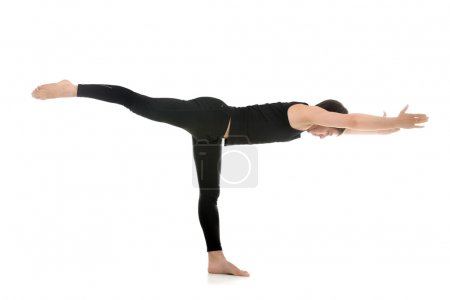 Photo for Sporty young man practicing yoga, doing stretching exercise for legs and spine, balancing in Warrior III posture, Virabhadrasana 3 on white background - Royalty Free Image