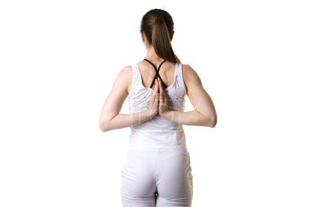Prayer gesture behind back