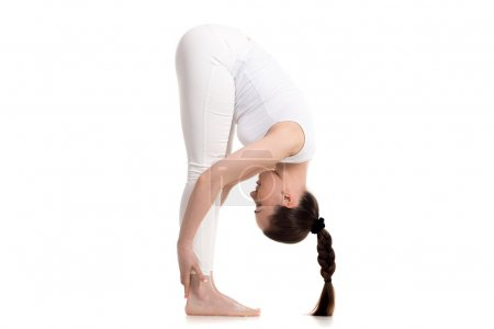 Yogi female standing in Intense Forward-Bending Pose