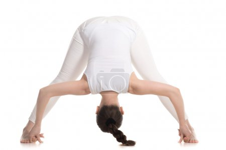 Yogi female standing in Wide Legged Forward Bend