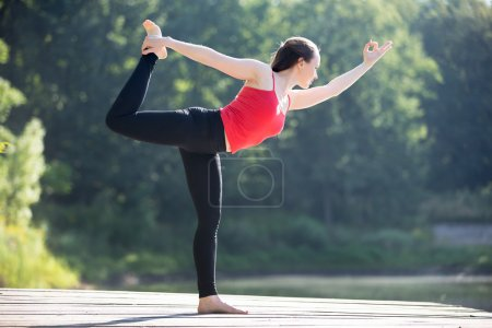 Teenage girl in Natarajasana pose