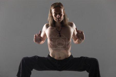 Sumo wrestler yoga pose