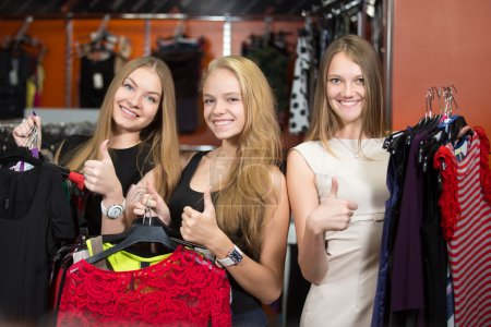 Cheerful teenage girls satisfied with shopping