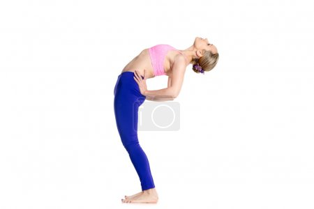 Photo for Sporty beautiful young blond woman doing Standing Backward Bend yoga posture, Ardha Chakrasana, Half Wheel pose, studio full length isolated shot on white background, side view - Royalty Free Image
