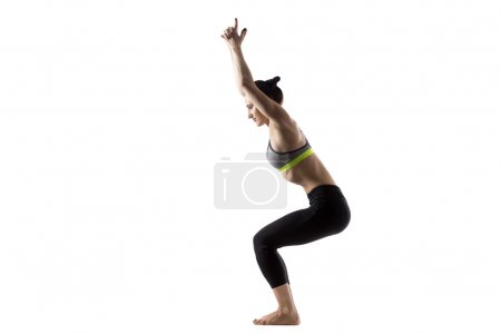 Photo for Sporty fit beautiful young brunette woman in sportswear bra and black pants working out, doing Chair pose, utkatasana, studio full length, isolated, white background - Royalty Free Image
