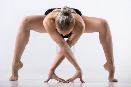 Forward bending Sumo Squat Pose