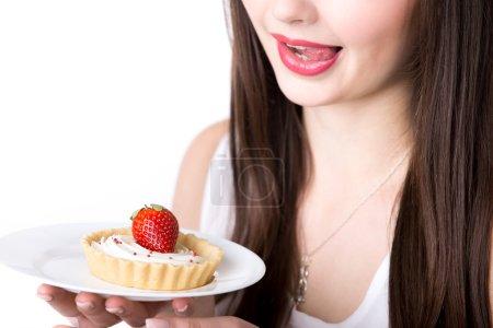 Female model with appetizing cake