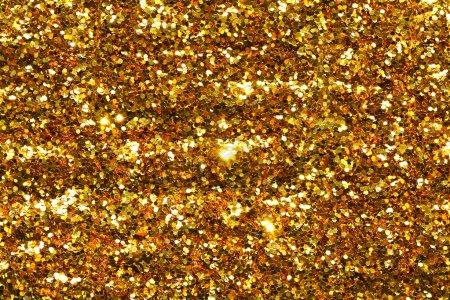 Photo pour Paillettes jaunes vacances, sable doré et texture poussière. Fond brillant doré. Surface métallique brun orangé . - image libre de droit