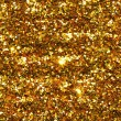 Holiday yellow glitter, gold sand and dust texture...