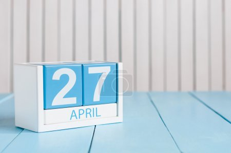 April 27th. Image of april 27 wooden color calendar on white background.  Spring day, empty space for text