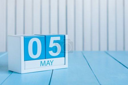 May 5th. Image of may 5 wooden color calendar on white background.  Spring day, empty space for text. International disabled rights  Day