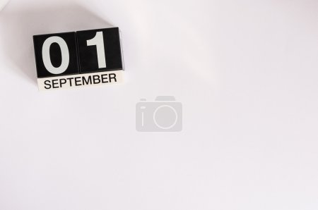 Photo for September 1st. Image of september 1 wooden black calendar on white background. Autumn day. Empty space for text. Back to school time. - Royalty Free Image